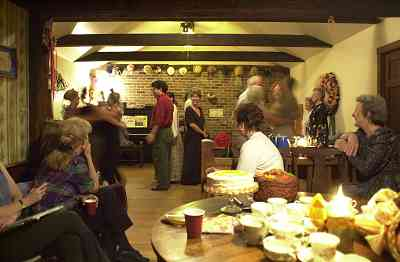 Dancing takes place in a comfortable room at the back of the house with an oak floor.
