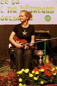 Ita Cunningham and her trophy for winning the senior fiddle competition at the Fleadh.