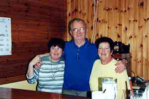 Majella, Willie and Marie Healy at their snack bar in the Mill Theatre.
