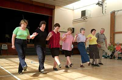 Six ladies from Mayo demonstrate the Polly Glide with Mickey Kelly at a workshop in Abbeyfeale.