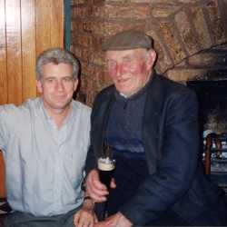 Gerard Kennedy with the late Joe Lynch of Valentia Island. Joe will be remembered for his help in reviving the Valentia Right and Left Set, which is often danced at the regular Sunday night ceilis at Gerard's Bridge Bar in Portmagee. Photo by Beryl Stracey.