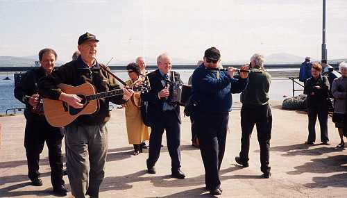 Musicians marching to Portmagee after sailing from Dingle during the set dancing weekend in May 2001.