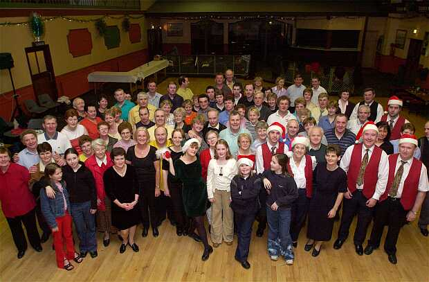 Some of the people attending the last ceili in the GAA Centre in Tullamore posed after the final set. The Fodhla Ceili Band are in Santa hats and waistcoats.