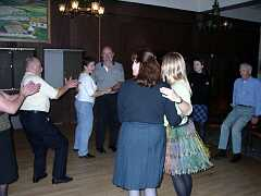 Tops applaud sides at the ceili in Detroit. Photo by Dave Braun